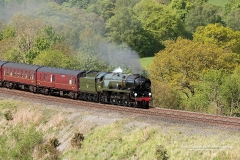 """On a bright sunny summers day,Merchant Navy Class """"British India Line"""" steams through Cumbria near Armathwaite engine number 35018 on the Carlisle to Settle line."""