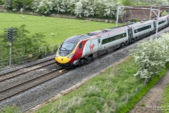 Virgin Class 390 Pendolino Train (390-138) on the West Coast Line near Penrith