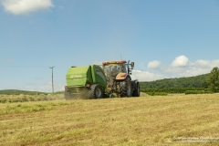 Tractors Hay Bayling on a summers day in Pant-Y-Dwr, Wales UK,
