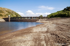 Extremely low water levels revealing the shoreline due to the current hot weather in the UK, Normally water would be overflowing the arches generating electricity. The Dam normally when full has 2000 million gallons for this purpose.