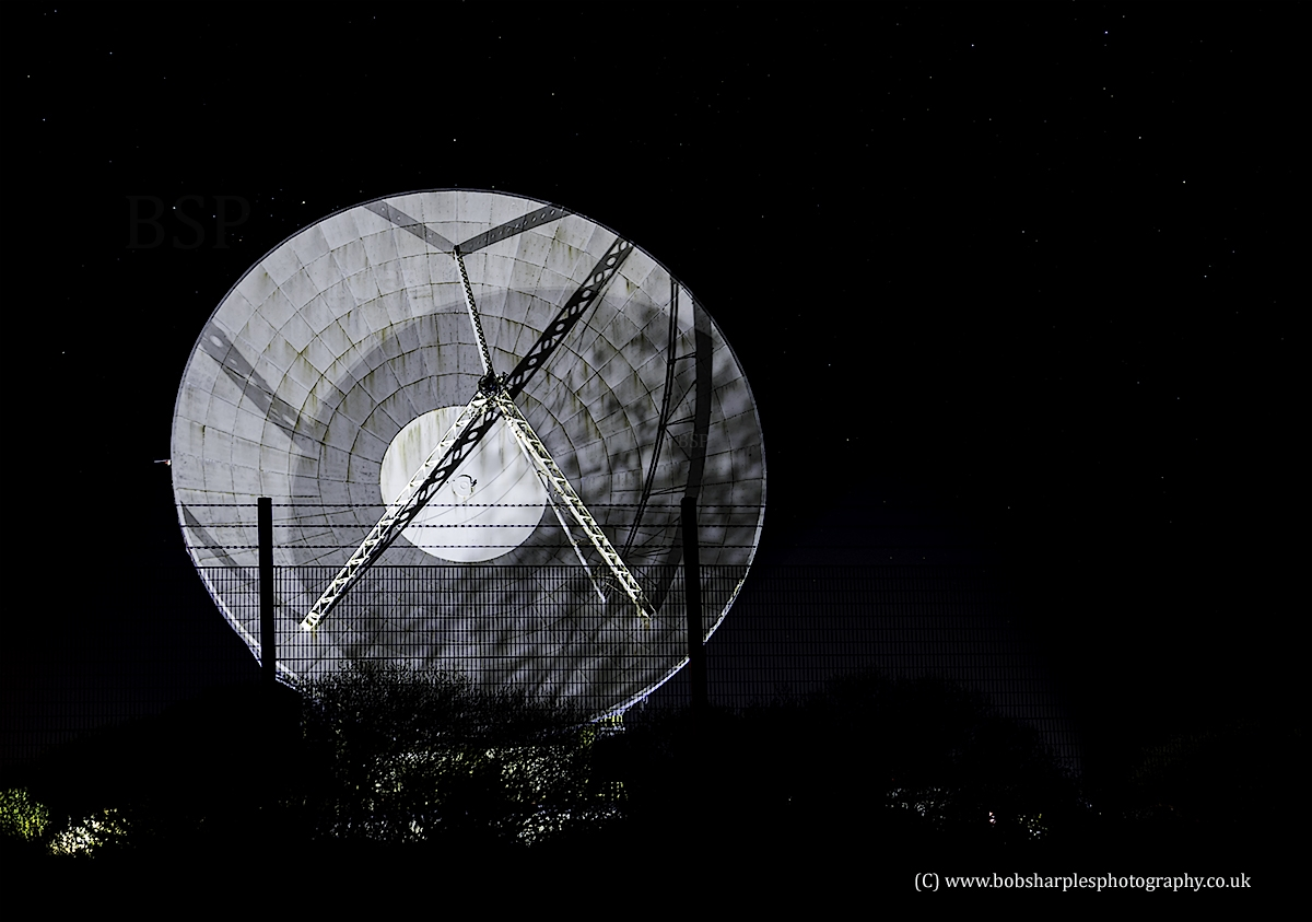 A floodlit satellite at Goonhilly on The Lizard, Cornwall, UK