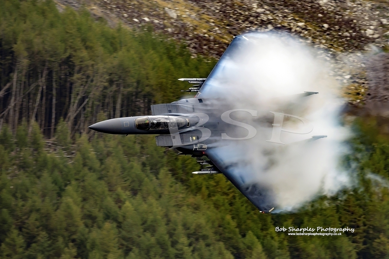 USAF F15-E Strike Eagle low level Training in Wales, varying degrees of fluff over the wings due to localised weather conditions