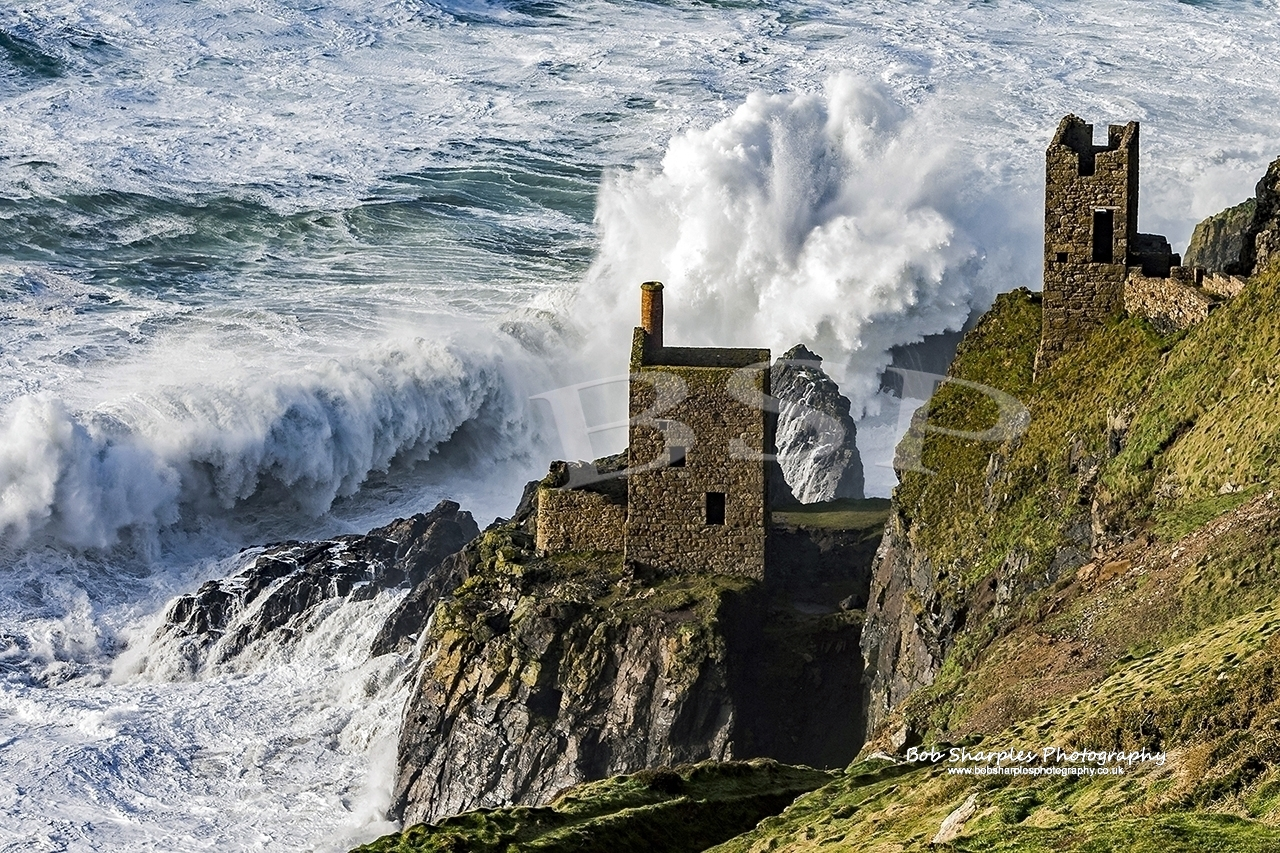 Storm Imogen creates huge waves and winds that batter the old engine houses at Botallack Crown Mines on the North Cornwall Coast