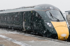 Class 801 Super Express Hitachi train arrives Penzance station during heavy snow blizzard