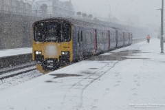 Commuter train arrives at Penzance during heavy snow blizzard